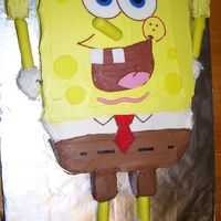 Spongebob  This was for a 2-year-olds birthday. The arms, legs and nose are breadsticks covered in fondant and the shoes are Mallomars (which kind of...