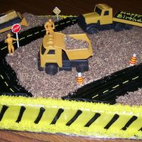 Road Work  The cake was half yellow and half chocolate with vanilla buttercream. I used crushed golden Oreos (with chocolate creme) for the gravel and...