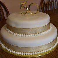 50Th Anniversary  Both cakes are yellow with raspberry filling and almond buttercream, covered with fondant. The balls/pearls are also fondant (hand-rolled...