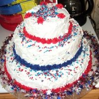 July 4Th My sad little 4th of July cake :( It was a 14, 10, 6, only the 10 was a double layer---simple white cake with buttercream icing and...