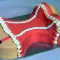 Bustier Cake   2-layer Chocolate cake , frosted with buttercream and covered with MMF.