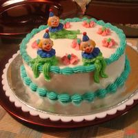 Clown Cake-Wilton Class My second cake. I wasn't too fond of the clowns, and they half melted on the way home. My son loved it though.