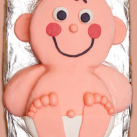 Curly Joe This is a baby shower cake I made for a friend of mine. I found the idea online so it is not original with me but I had a lot of fun doing...