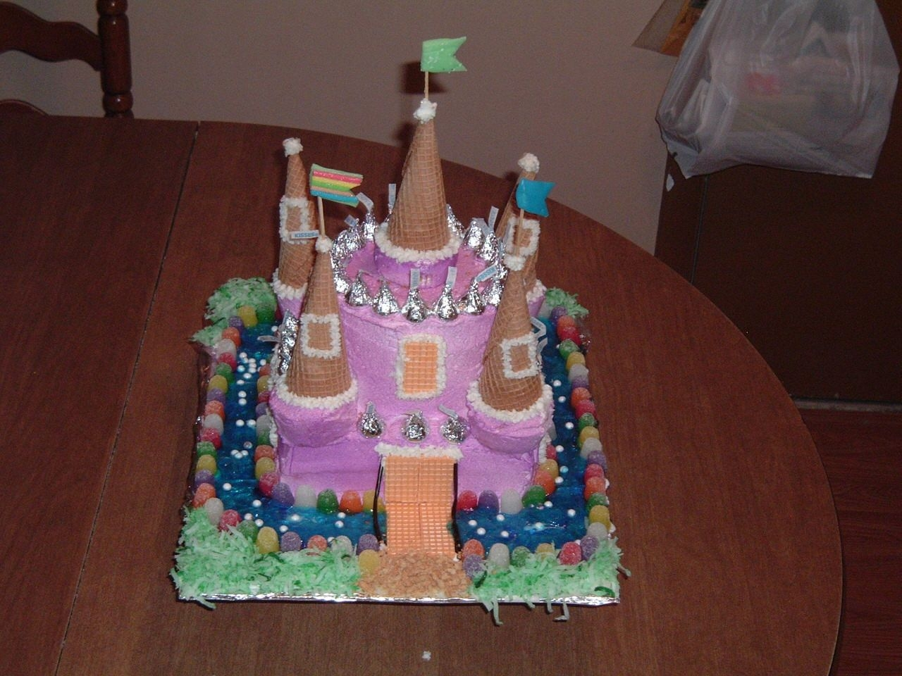 Enchanted Magical Castle The castle has 5 towers made of ice cream cones, the main body is white cake with white icing. I air brushed the cake to a light purple....