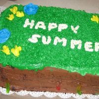 Happy Summer For a Grade 4 class. As you can see, it moved on the cake board, but oh well. It is a double-layer 9 by 13 white cake. The mud is chocolate...