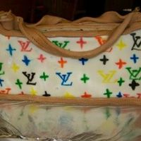 L.v. Purse chocolate cake coveredin mmf and hand drawn symbols