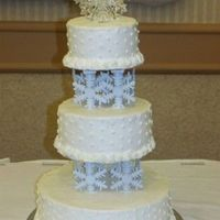 Snowflake Wedding Cake snowflakes are plastic and hot glued to the top of the pillares