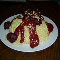 Spaghetti Cake   Yellow cake with BC noodles.Meatballs are choc cake balls.Sauce is a combo of red BC and strawberry jam with red & brown food gel.