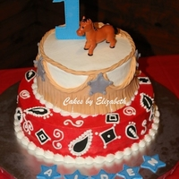 Cowboy Cake 8 and 12 inch cakes with buttercream icing and fondant accents. Horse is plastic toy. I made this cake for my nephew's birthday party...