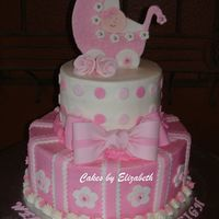 "Carriage Baby Shower 6"" and 10"" rounds covered in BC with fondant accents. I made this cake for my niece's baby shower."