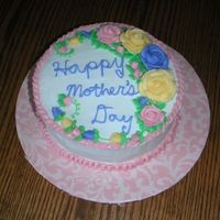 Happy Mother's Day Cake Buttercream icing and decorations, cinnamon swirl cake. Hersery's kisses for the center of three roses. Got the idea off of some...