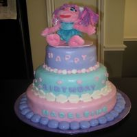 Abby Cadabby 3 tier chocolate, vanilla, chocolate with rolled buttercream frosting and decorations