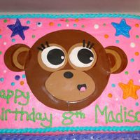 Monkey Cake  This was a cake for a little girl Madison. She loves the clothing store that this monkey comes from. Fondant for the face and buttercream...