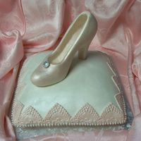 Glass Slipper On A Cake Pillow The shoe is done in white chocolate. It took for ever to carve out the inside of the shoe. Won't do that again. I think this cake...