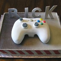 Xbox 360 The controller is in fondant and the rest is buttercream with fondant accents. the letters are gumpaste.