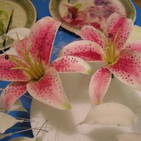 Stargazer Lilly Here are 2 of the 12 stargazer lilies that I am making. The painting takes the longest.