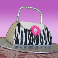 Zebra Striped Purse This cake is done in fondant with a gumpaste hanle with a wire all the way through it.