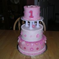 1St Birthday Cake I made this cake for my daughter's first birthday- making a tiered/stacked cake with the top tier just for her! Buttercream icing-...