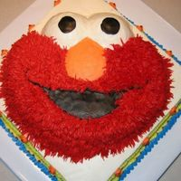 Elmo Cake (Ii) Elmo is a marble cake and red, red, red bc icing. The square layer is fresh lemon cake with blackberry filling.