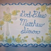 Elongated Shell Cross Cake   1/2 sheet dark chocolate fudge cake with buttercream. All decorations are done in buttercream.