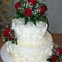 Red Roses And Scrolls  This was a cake I did for a 40th Anniversary. The cake was butter with raspberry filling and whipped cream bc for icing and decoration. The...