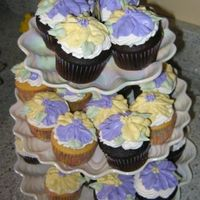 Pansy Cupcakes Chocolate and vanilla cupcakes decorated with pansies.