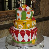 Nature's Whimsy - Amber's Cake  12-9-6 Topsy Turvy Cake. Inspired by colors of nature, the bride is a Botanist. Apple Red, Daffodil Yellow, Granny Smith Apple Green,...