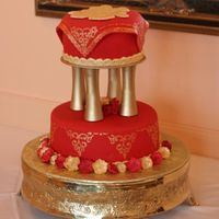 "Asian Design Wedding Cake (Zhijun Li's Cake)  Two tier 10' - 7"" wedding cake in Asian design. Red rolled fondant covered. Fondant square draped over top, to give the illusion..."