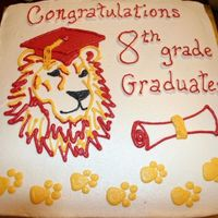 Graduation cake for school graduation. lion mascot. colors are red and gold. All buttercream