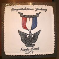 "Eagle Scout 16"" double layer chocolate/yellow cake All buttercream. Decorated to look like the Eagle scout medal."