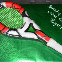 For Leo Carved tennis racquet cake from rectangular cake & oval cake; covered in fondant, accents in royal icing and fondant. Tennis balls are...