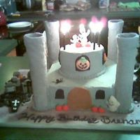Haunted Castle This cake was done for my son's 8th Bday. He begged for a Haunted Castle.This was my first castle. The turets are MMF covered, the...