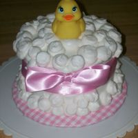 Duckie Baby Shower Made this for a friend. I covered the cakeboard in pink gingham contact paper that i had found for .67 a roll! (woo hoo!) WHite chocolate...