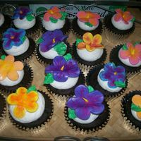 Aloha Cupcakes! wedding shower with a Luau theme. i made the flowers with the 5 petal rose cutter... dusted them after they dried with asst. colored petal...