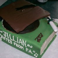 Graduation covered in fondant. Mortarboard made of candymelts b/c i did not have time to let fondant dry out!i like it! :)