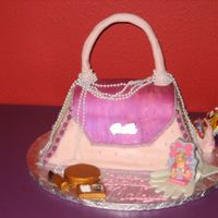 Purse Cake   My first purse cake. Iced with buttercream and covered in mmf.