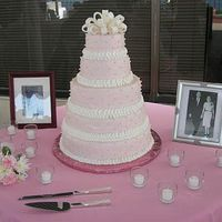 First Wedding Cake  This was my first wedding cake order. Bride wanted pale pink. It's buttercream frosting with fondant pearls and bow. I was very...