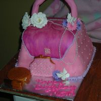 2Nd Purse Cake This is my 2nd purse cake and my first actual order. The cake is almond amaretto frosted with buttercream and fondant. Compact and lipstick...