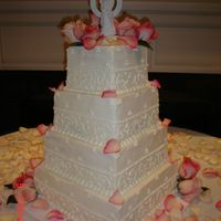 My First Wedding Cake This was my first wedding cake for hire, and it was slightly stressful. 3 tiers are white pound with 2 layers of raspberry buttercream and...