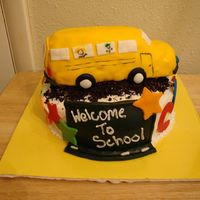 Colins First Day Of School I made this for my friends son's frist day of kindergarten. He was super excited and he loves my cakes. the bus is RKT covered in MMF...