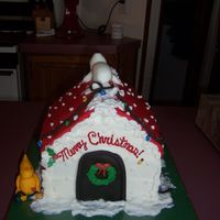Snoopy At Christmas I made this for my family christmas party. its four layers of alternating chocolate and carmel cake. iced in buttercream. all decoration...