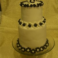 Black Tie I made this for our school auction that was Black and White in theme. The party was great! My husband was so proud of my cake that HE...