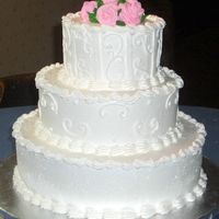 Pink Roses 3 tier wedding cake with scroll work and pink buttercream roses.