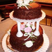 Chocolate Tier Cake My first tiered cake. Push in pillars made that very easy! Chocolate Explosion Cake with whipped ganache filling (YUMMY!) and chocolate...