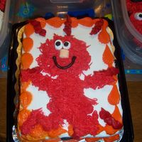 "Elmo Cake  Freehand Elmo with the ""grass/fur"" tip and mini marshmallows for the eyes and nose. Used a partially decorated cake I got from..."