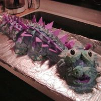 Dragon Cake  Decided to post this here, also, because it was made specifically for a Chinese theme party. Dragon is buttercream frosting with white...
