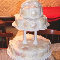 Seashell Tiered Cake Three tiers, chocolate fudge cake filled with chocolate fudge frosting, topped with vanilla buttercream and then MMF. White chocolate...