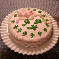 "St. Patty's Day Cake The ribbon says ""Good Luck + Erin Go Braugh!"". Chrysanthemum flowers and shamrocks from buttercream. Crown shell edge and reverse..."