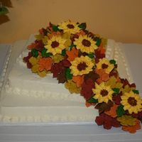 A Touch Of Fall  The flowers and leaves are made from royal icing. A spice cake topped with uttercream icing. I added a tbs of brown sugar to each batch of...