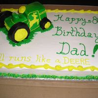 80Th Birthday Cake With 3-D John Deere Tractor Yellow butter cake with buttercream icing. Tractor was two small pound cakes (store bought) and a the wheels were made of the small...